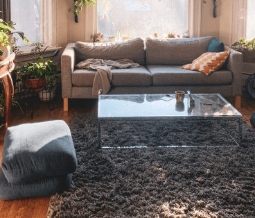 comfortable lounge setting with spiral grey woven rug